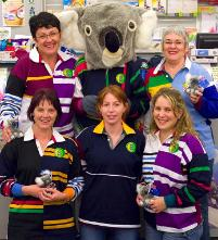 PhotoID:4657, Shirley is in disguise for help raise funds for her beloved koalas. CQU Bookshop staff show off the Canterbury Uglies which are now on sale.